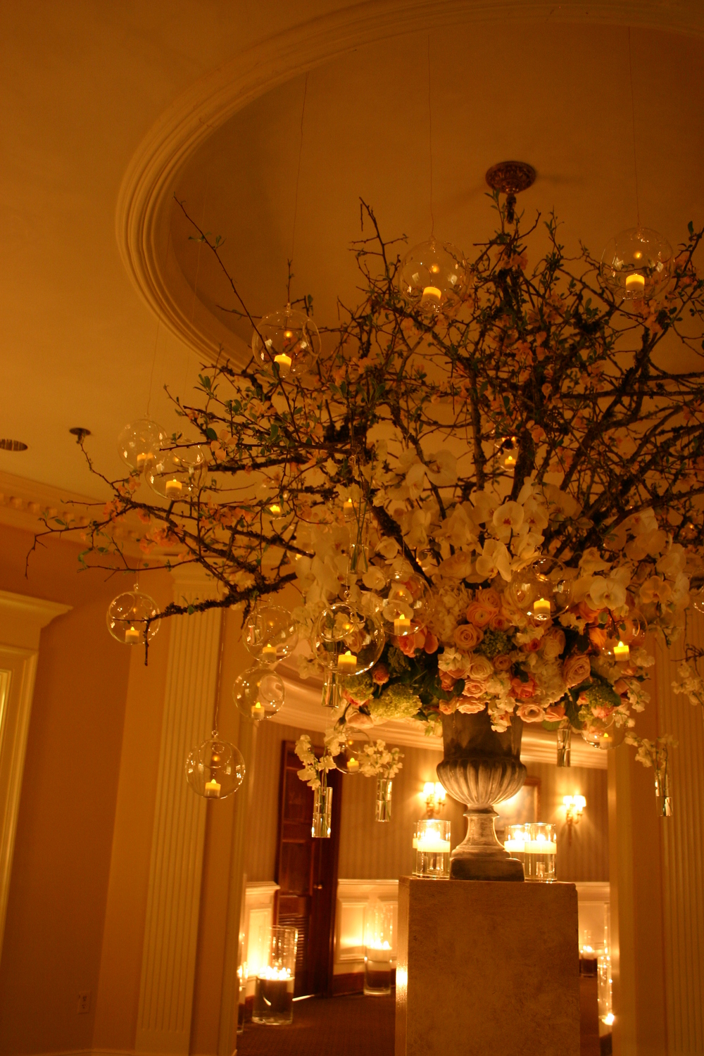 Entry arrangement of Quince, Phalanposis Orchids, Roses and Hydrangea at The Memphis Country Club