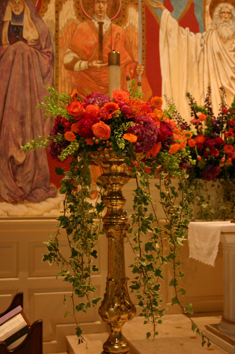 Candle arrangement at St Johns Episcopal Church. Hydrangea, Hypericum, Gerbera Daisies, Orchids, and Roses.