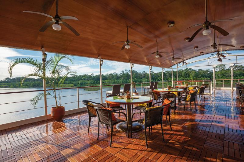 The spacious Sun Deck on board the stylish Amazon Star riverboat sailing in the Peruvian Amazon.