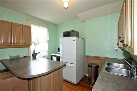 740 logan ave kitchen before.jpg