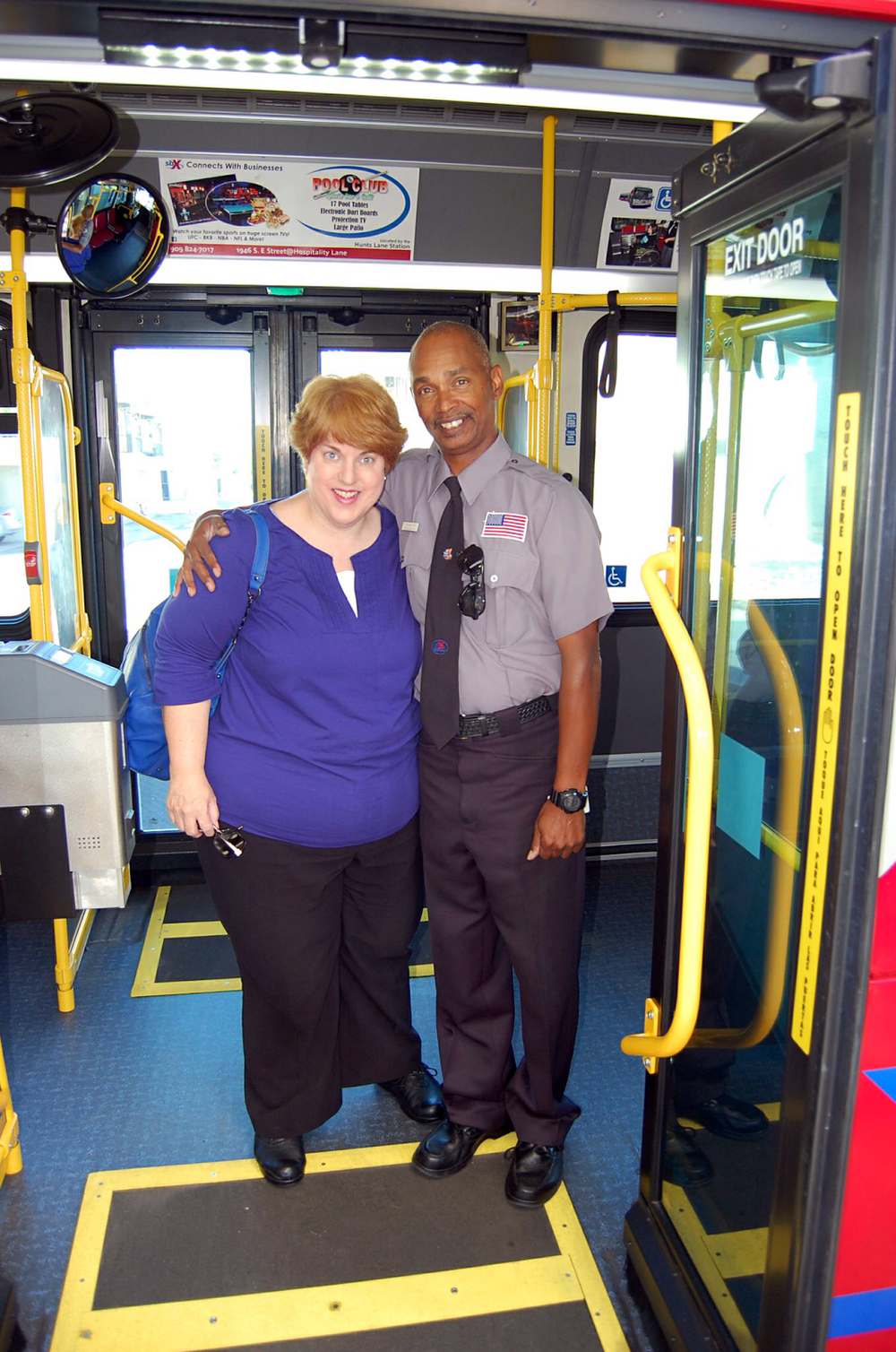 Picture of Connie with bus driver standing on bus exit ramp