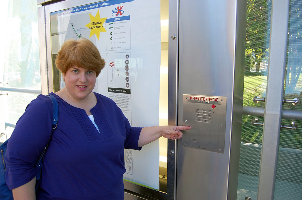 Connie pointing to the 24 hour call box