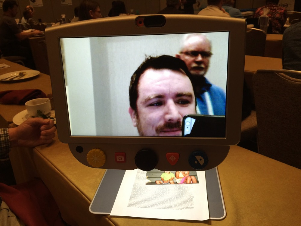 Self-view mode of two men in monitor