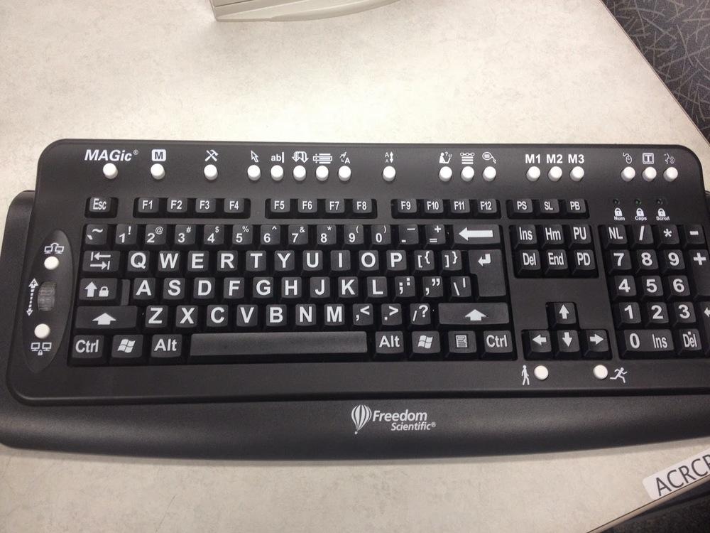 black keyboard with large white keys
