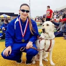 Charlotte Brown, Pole Vaulter, who is Blind sitting with her Guide dog vador