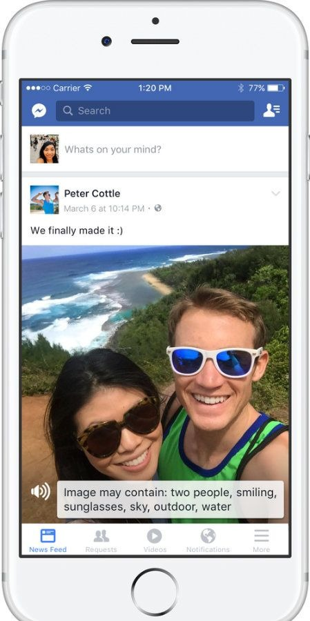 Picture of a woman and man standing near the ocean in a picture on Facebook