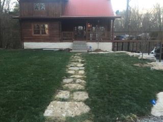Natural stone walkway and sod installation