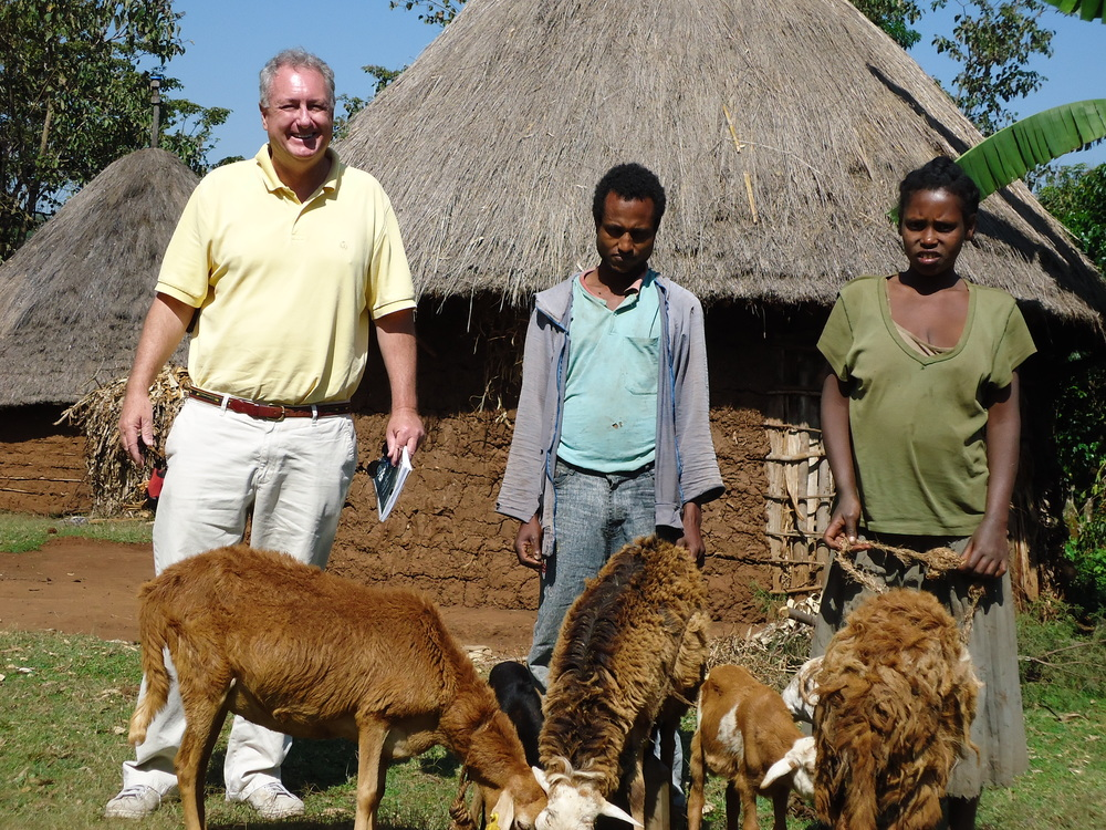 PETER WITH ETHIOPIAN FAMILY AND THEIR LIVESTOCK