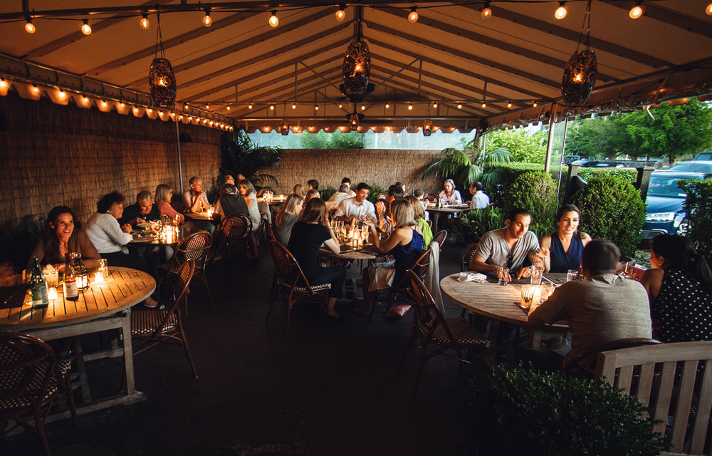 In the warmer months... comfortably eat al fresco on our garden patio.
