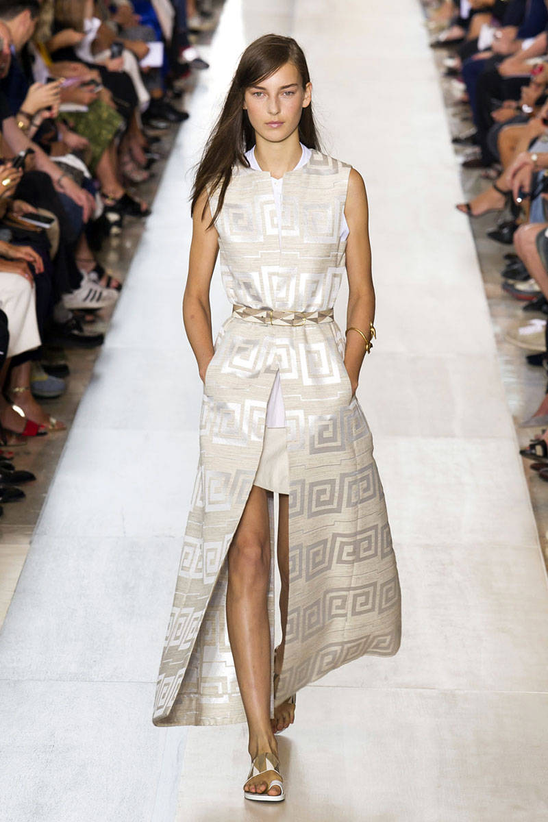 Tory Burch.  This is a longer style used as a dress over a shorter dress