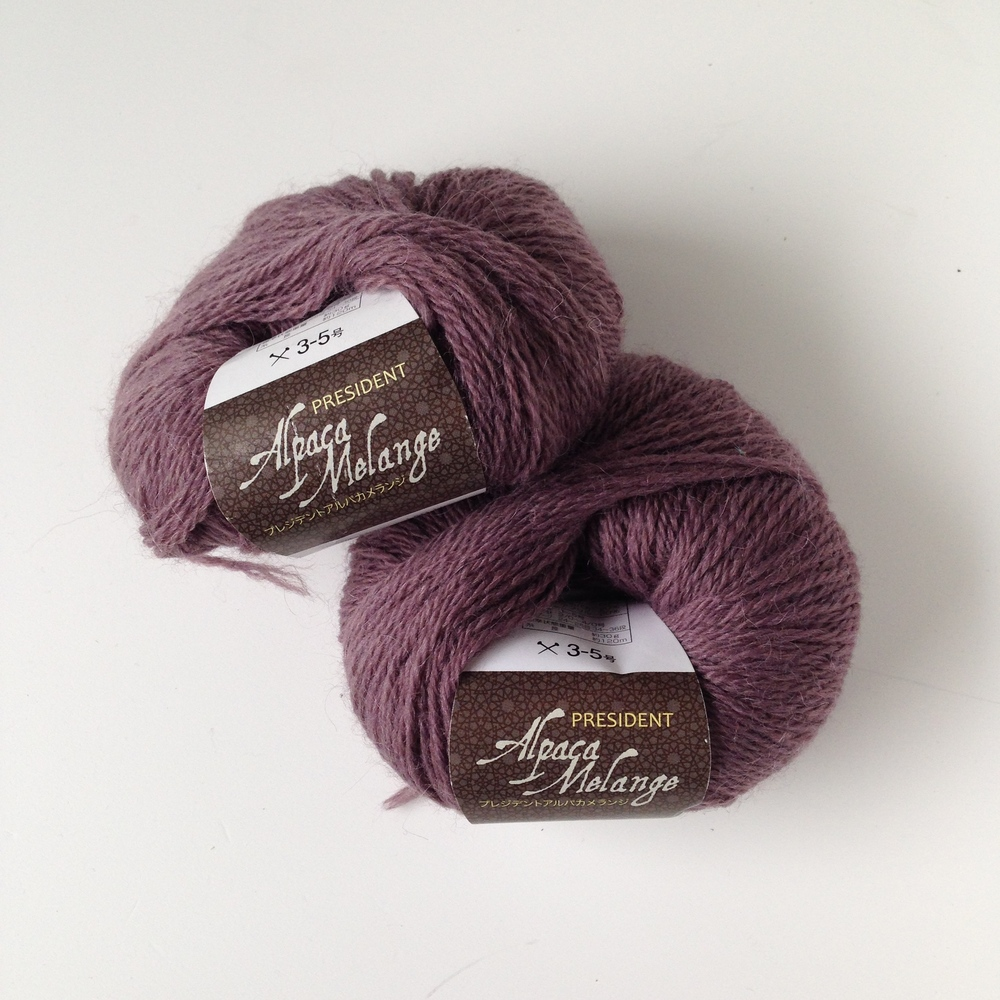 Alpaca blend (wool/alpaca). I'm currently using this to knit an eyelet/cable beanie! Bought in town!