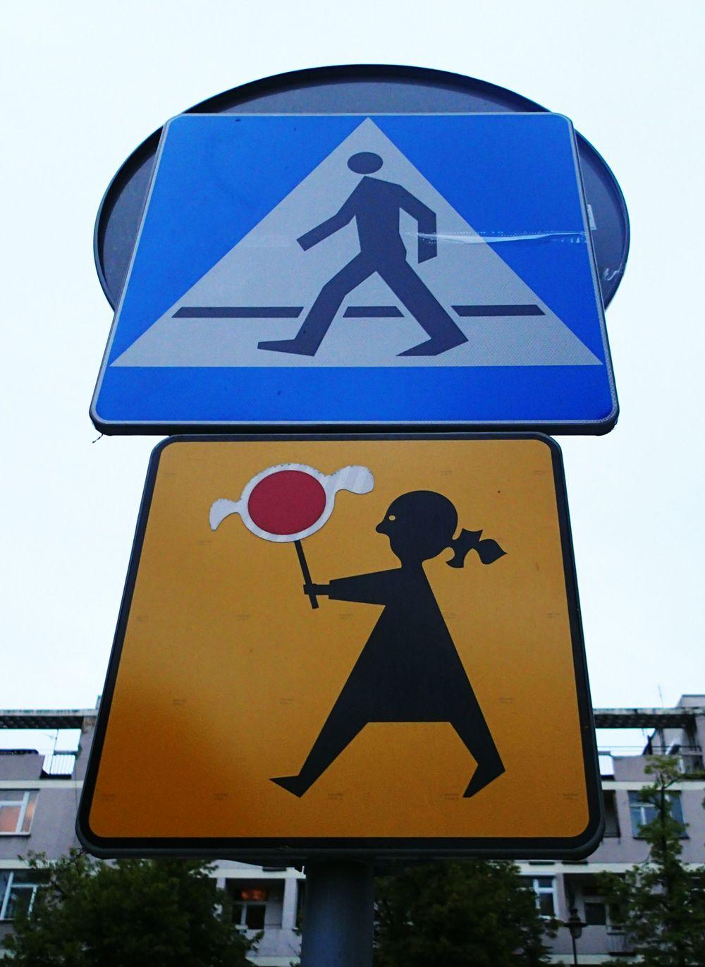 """Sign warning of malformed children holding lollipops?  Nope, it's just a boring """"przejście dla pieszych jest szczególnie uczęszczane przez dzieci.""""  You don't read Polish? Ok, ok. It means """"pedestrian crossing used by children."""""""