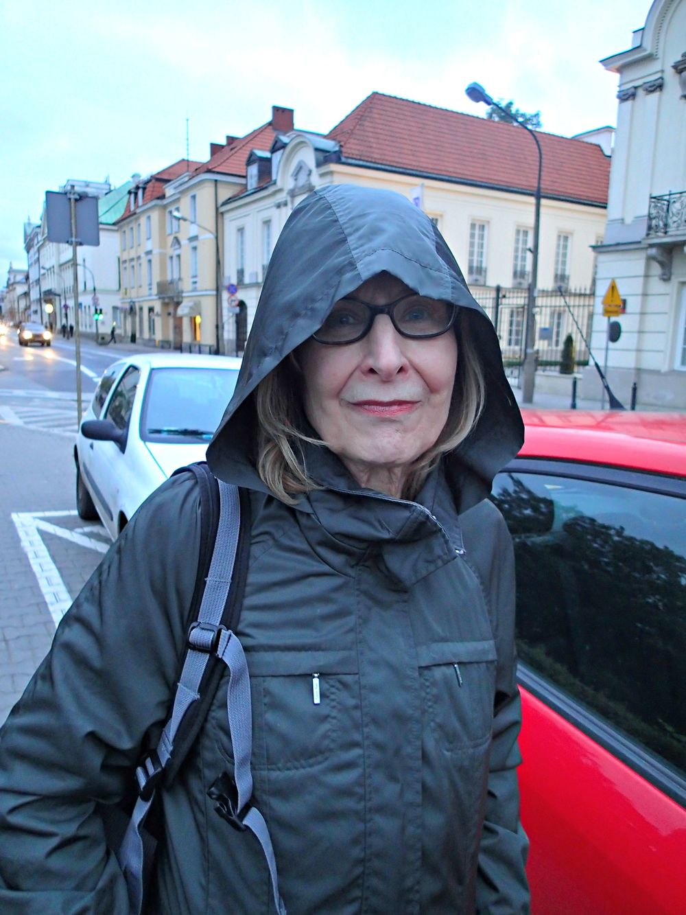 My mom in Warsaw as rain begins to fall.