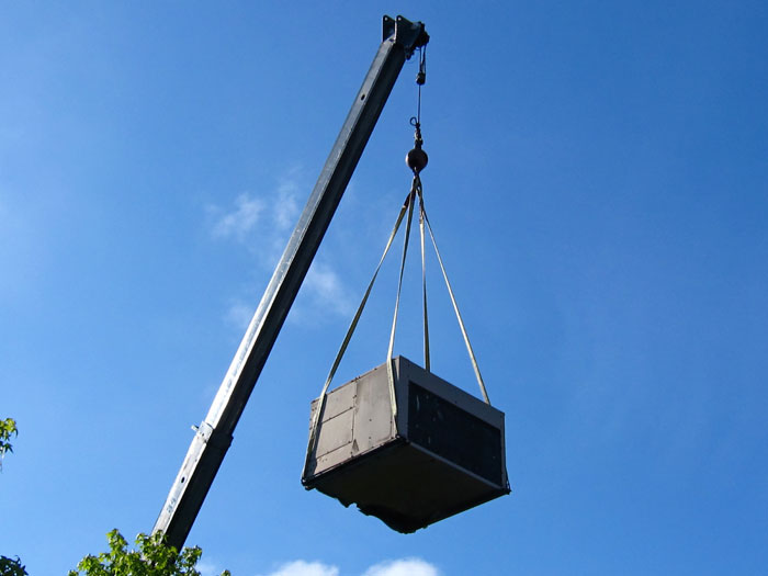 Crane-lifting-air-conditioning-unit-1-1.jpg