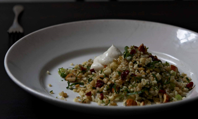 Andrew McConnell's Cracked wheat & freekeh salad with preserved lemon & barberries. Photography by Earl Carter.