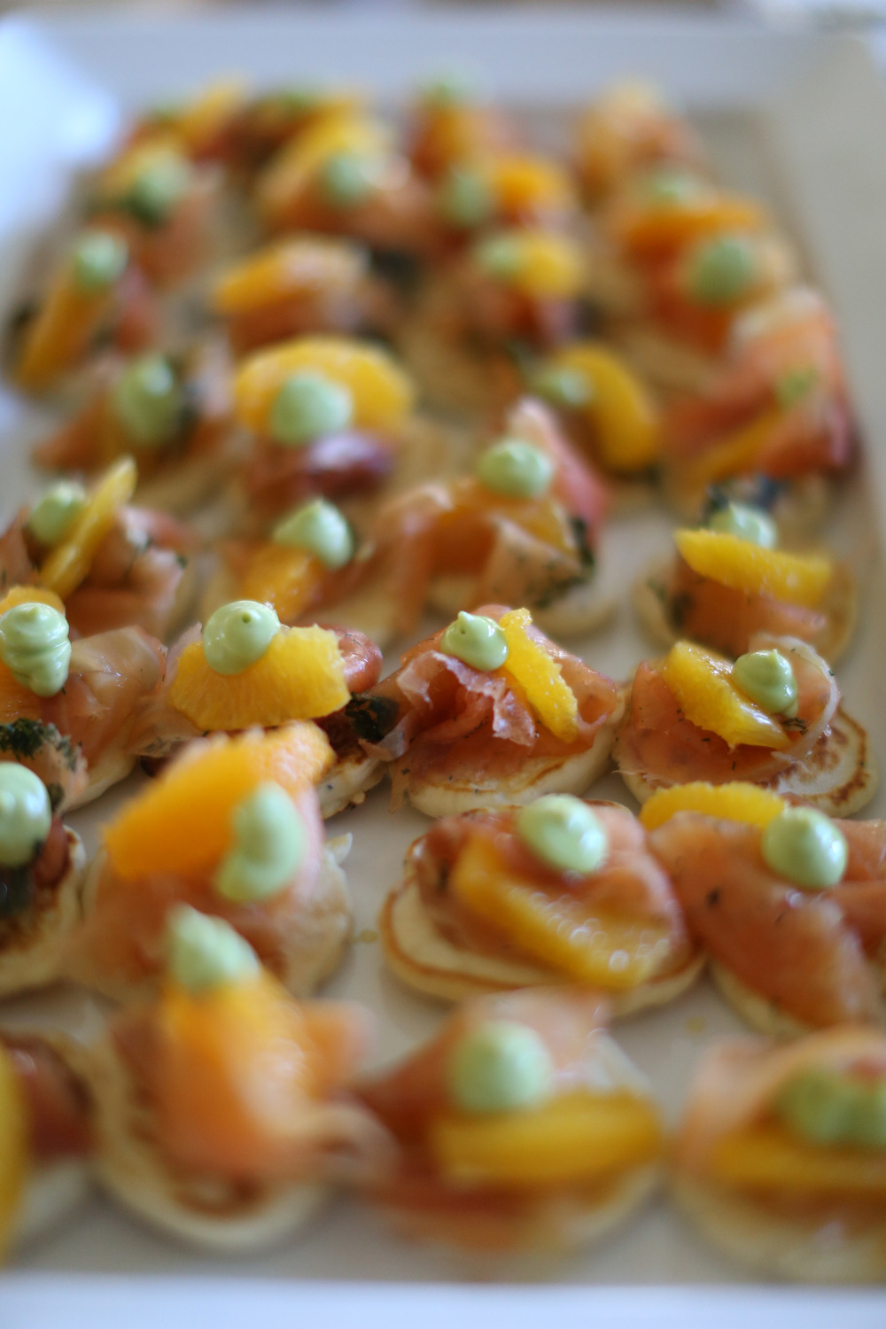 Cured Salmon & Poppyseed Pancake Canapes, with avocado mousse and orange segments