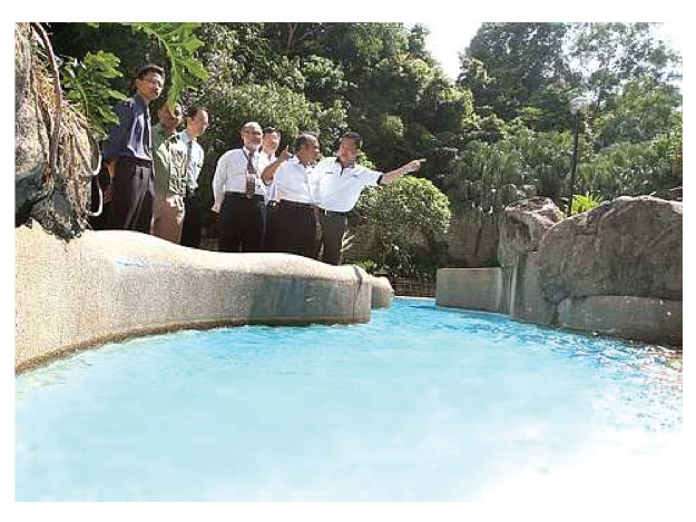 Photo: Prof Chan Ngai Weng showing Tuan Hj Hanapi the N-Park Children's pool, one of many spots  where water saing will be implemented.