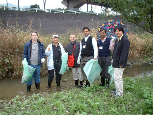 Prof Chan and other participants helping out in a river clean-up activity