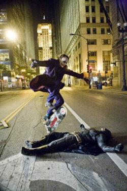 iheartchaos :     Heath Ledger as The Joker skateboarding over Christian Bale as The Batman. Pretty badass.