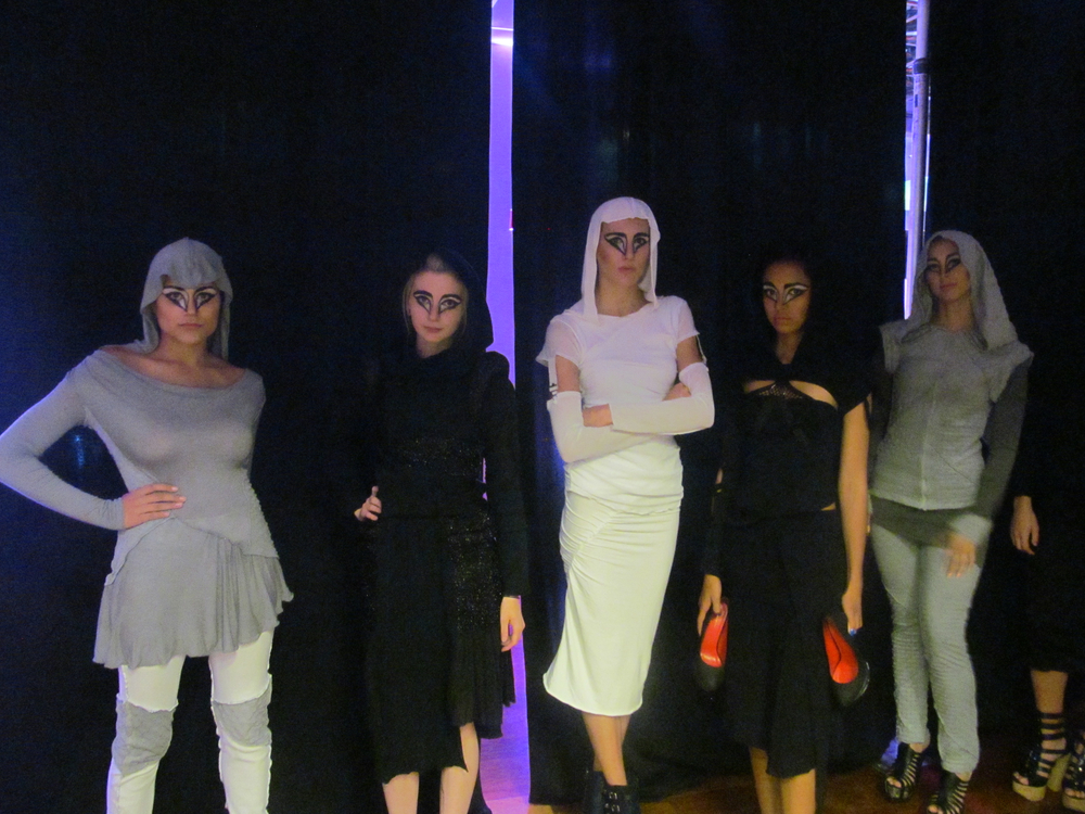 BTS with No Human Intentions models before they walk the runway.