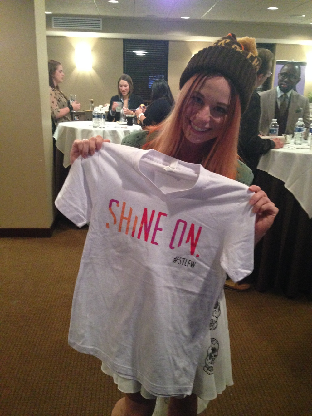 After checking in, I headed over to get my goodie bag and Shine On shirt at the #STLFW table!