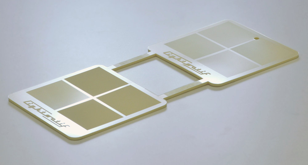 Injection molded TPU demonstrator sample with different soft-touch / anti-glare micro-pillar textures.