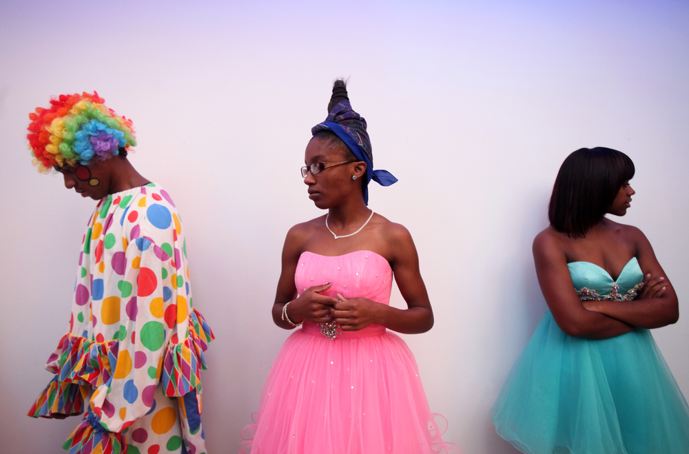 Chel'sea Green (center), 16, of Roanoke, Va., waits for instructions backstage with her fellow amateur models during a dress rehearsal for owner of Hair Attitudes, Greg Addison's, fashion show at the Taubman Museum of Art. The Glamour Amusement Fashion Show featured a circus theme.