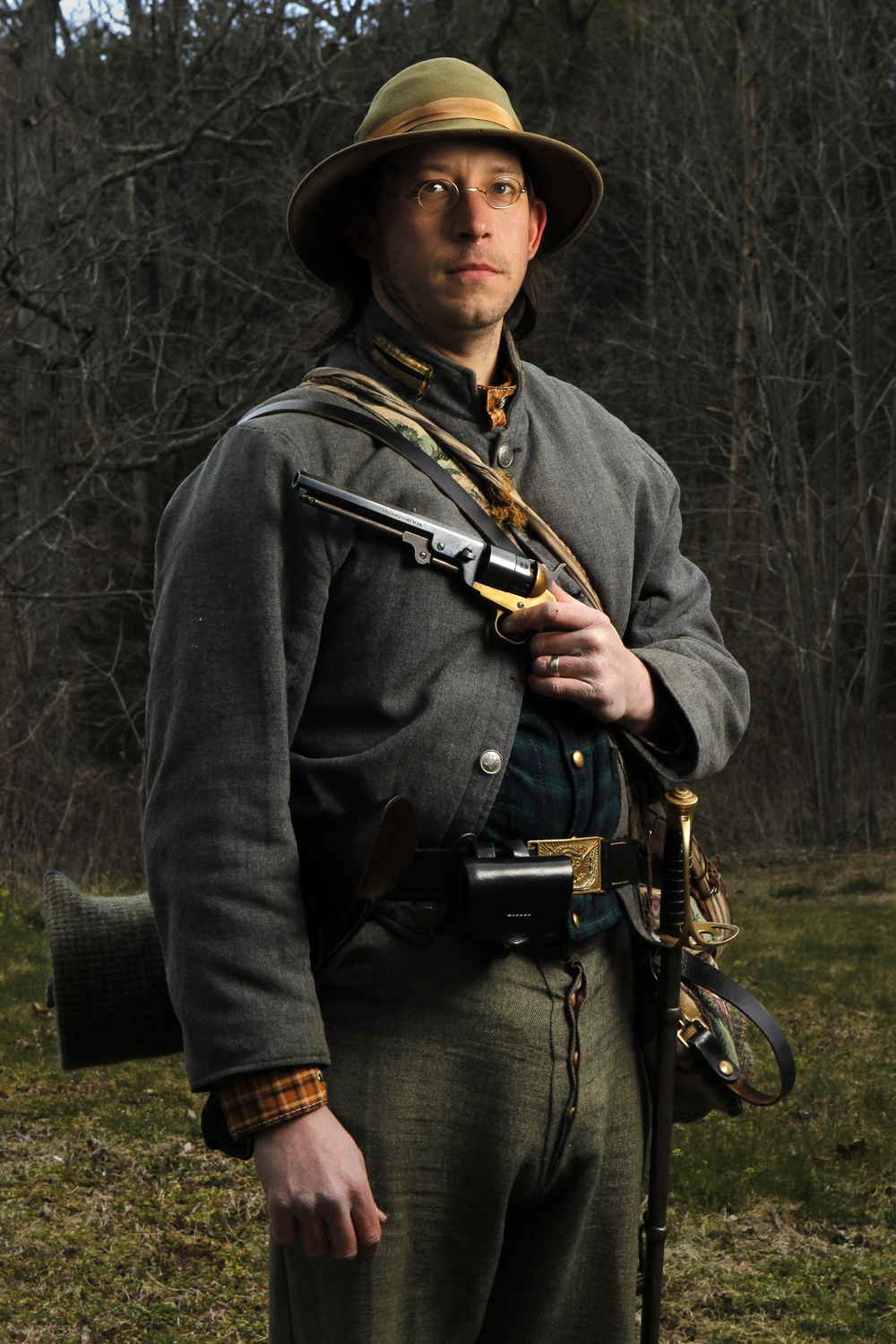 """Raymond Douglas Camper III, 37, of Roanoke, is photographed with a Spiller and Burr model of an 1851 Colt Navy Arms. """"We do Civil War reenactment, me and my reenactment unit,"""" Camper said. """"I don't normally live-fire the weaponry.""""   See full project here."""