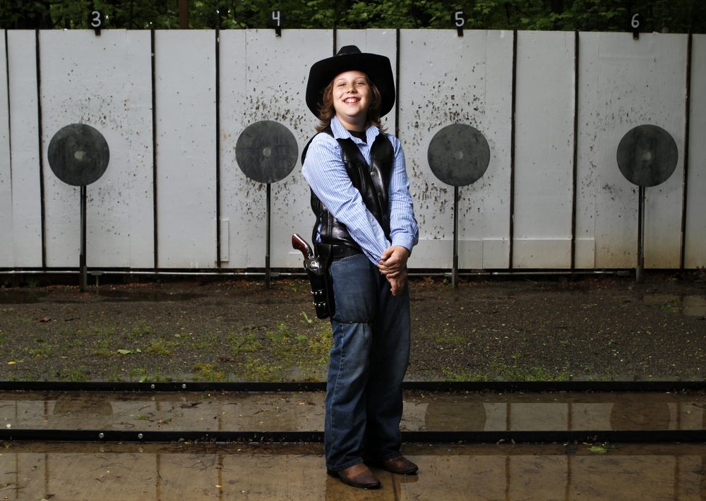 """Luke Love, 10, of Salem, is photographed with a Colt Vaquero .45. """"I play football, basketball, baseball, soccer and this - fast draw,"""" Love said. Love has participated in the Cowboy Fast Draw for three years and won the Virginia State Championship.   See full project here."""