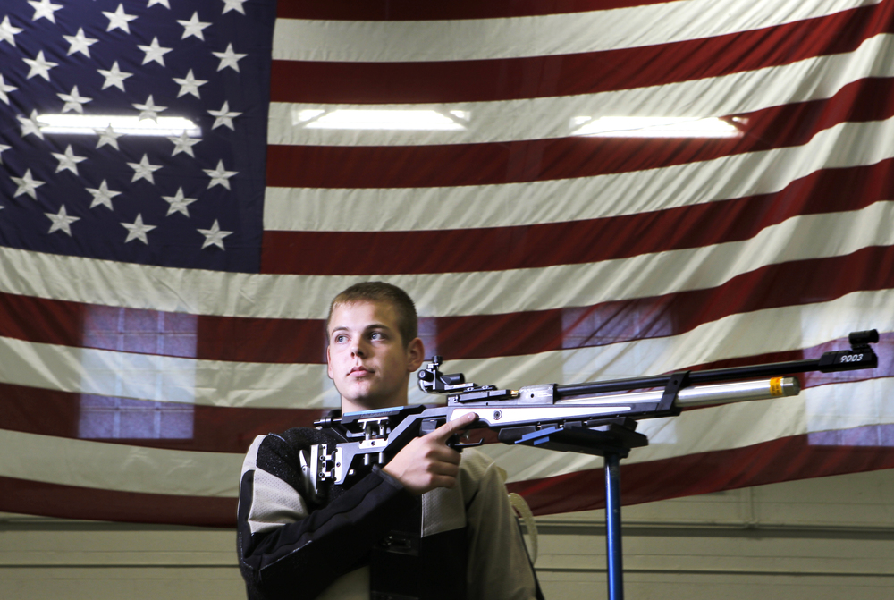 """Carter Santrock, 16, of Rocky Mount, is photographed with an Anschutz 9003. """"I'm a member of the FCHS AFJROTC,"""" Santrock said. """"We travel around to different competitions and we shoot up against other schools and see who's better.""""   See full project here."""