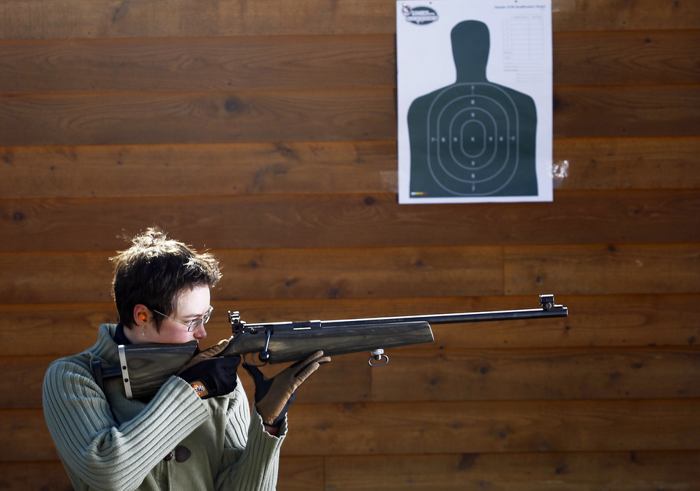 """Kim Swaneveld, 31, of Salem, is photographed with a Marlin 22 Longrifle. """"I mostly do target shooting,"""" Swaneveld said. """"When I lived in Alaska, I helped coach junior rifle. I worked with special needs kids. That was kind of the beginning of shooting for me, and it was more about understanding your body and sight-pictured trigger control and how to kind of teach kids to be successful.""""   See full project here."""