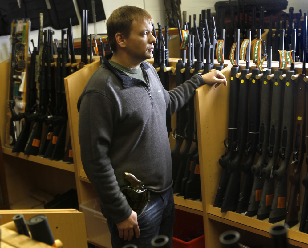 """Aaron Cochran, 36, of Salem, is photographed with a Smith & Wesson .38 Special. Cochran has managed Trader Jerry's in Salem for 13 years. """"I actually require all my employees to carry,"""" Cochran said. """"I just feel safer with everybody having their own way to protect themselves.""""   See full project here."""