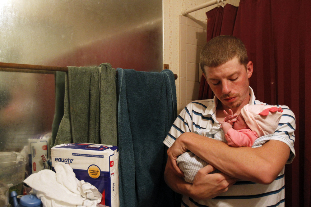 J.D. bonds with his newborn girl, Charlize Lucille while Jillian showers to clean up a little over an hour after birth. The warm, steamy air in the bathroom helps to clear Charlize's nasal passages, and ease her lungs.