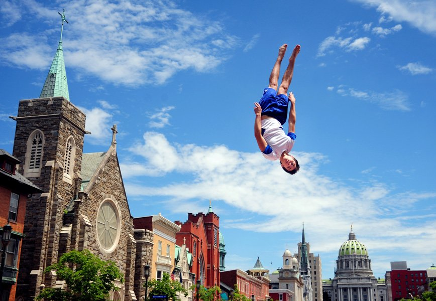Danny Fleet, 16, of Connecticut, performs flips and twists on the trampoline during the American MusicFest in Harrisburg, Pa. Fleet was a member of the New England Trampoline Show Company, and performed three shows at the event in downtown Harrisburg.