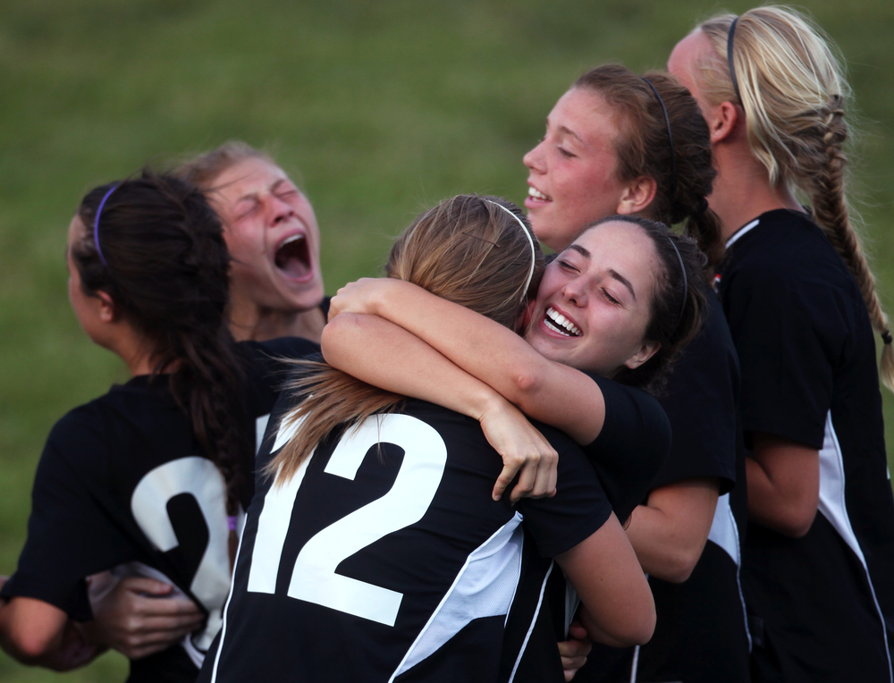 Jefferson Forest Cavalier teammates celebrate after winning the Region III semifinals against the Lord Botetourt Cavaliers at William Byrd High School in Roanoke, Va.  Jefferson won 2-1 after double overtime and penalty kicks.