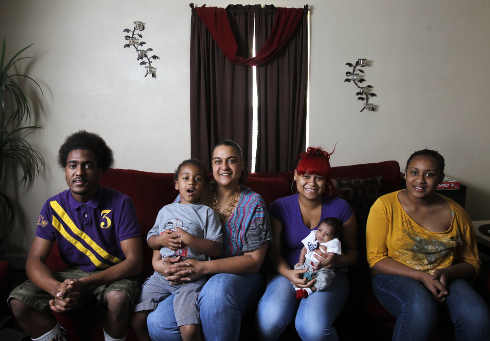 "Shannon Huff became pregnant at 16 and is now a mother of four, with the recent addition of one grandson. Cursean Austin (from left), 16, Andre Ingram, 4, Sharontay Huff, 20, Kay'Mari Barber (who was three-weeks-old in this photo), and Calasia Austin, 11, make up Shannon's family. ""I do think I'm blessed to be a single mother and have four (kids),"" Huff said."