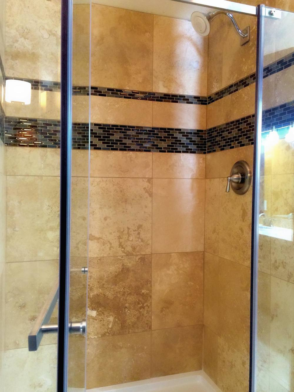 Updated Master Bath, includes shower with travertine & Kohler Moxie Bluetooth Speaker