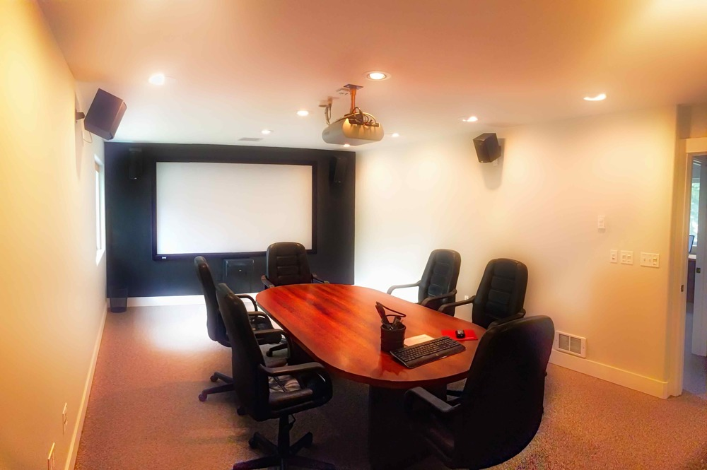 "The upstairs ""Boardroom"" features a screen and projector and audio system, with comfortable seating around the conference table for 6-8 comfortably."
