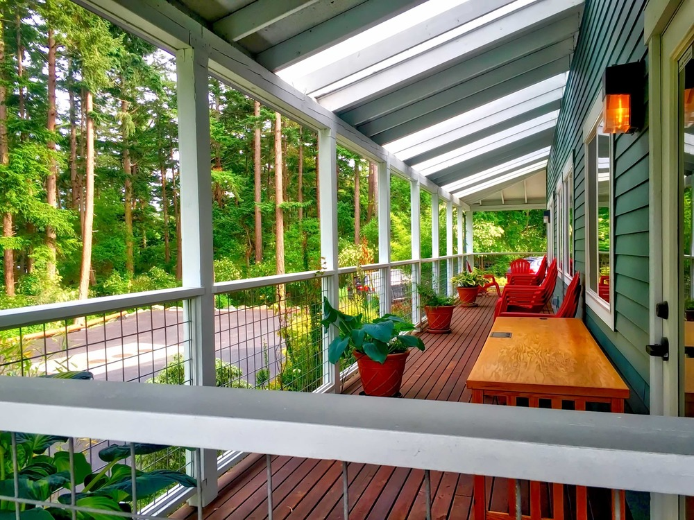 With ideal weather in the summertime, the outside wrap-around deck with covering is an ideal place to work in a fresh-air environment.