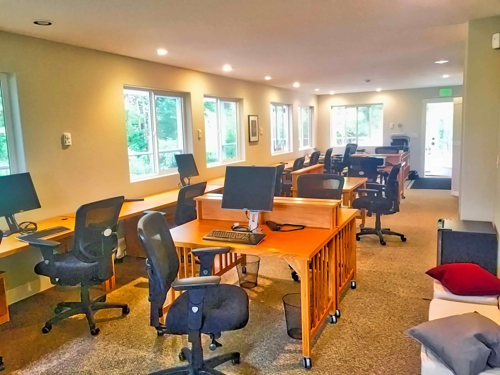 The main coworking space on the first floor offers comfortable chairs at dozens of workstations.