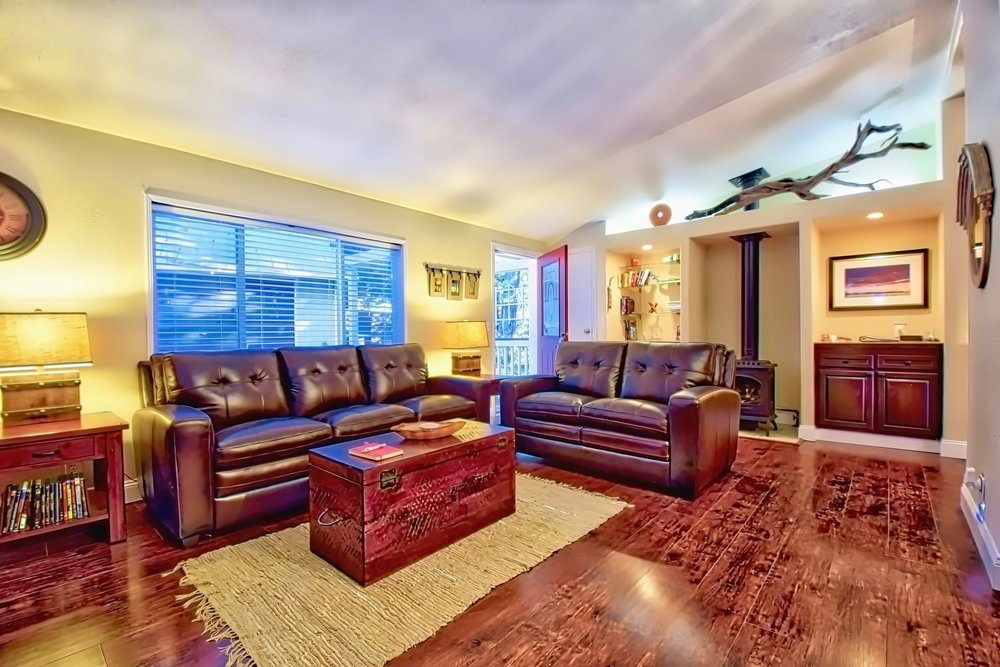 A spacious living room with comfortable seating and modern/rustic decor. Sit back and read a book, listen to music, watch a movie or just enjoy conversations.