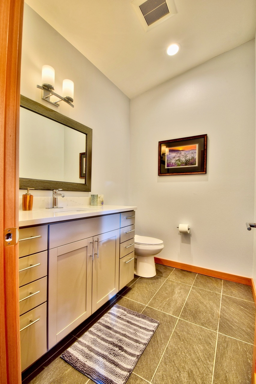 The main level features a 1/2 bath located just off the main entry.