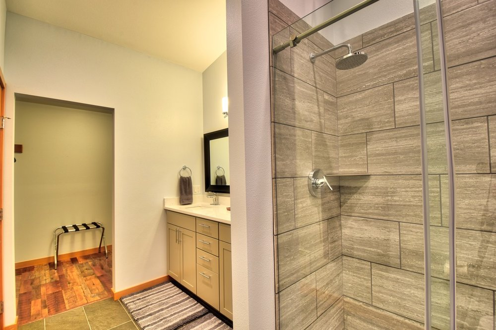 The en suite master bathroom also features a walk-in closet.