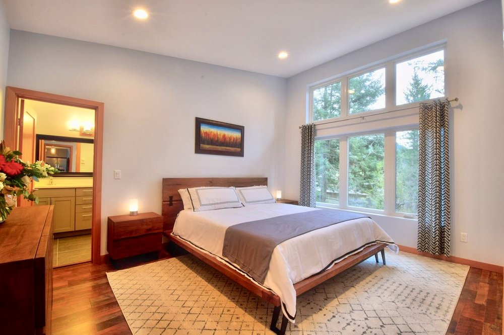 Spacious Master Bedroom with en suite bathroom and walk-in closet.