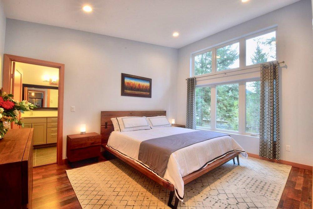 Spacious Master Bedroom with en suite bathroom and walk-in closet.