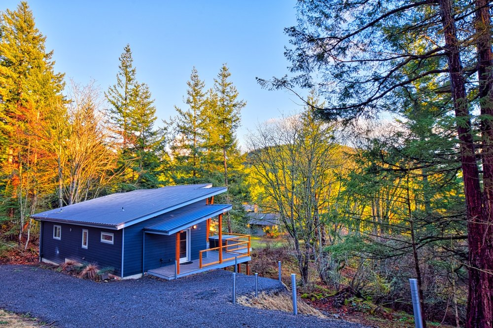 Perched on the hillside, filtered water views of the Salish Sea from the large deck.