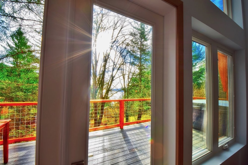 Views through the french doors in the living area out to the large deck.