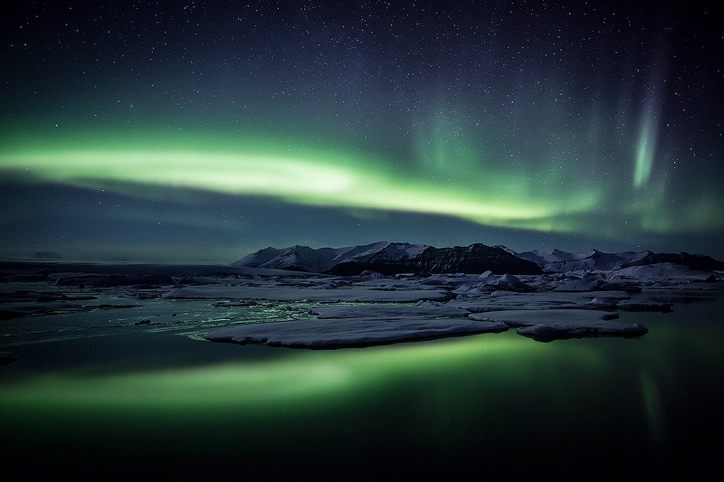 Aurora borealis display over Jökulsárlón glacial lagoon, southern Iceland