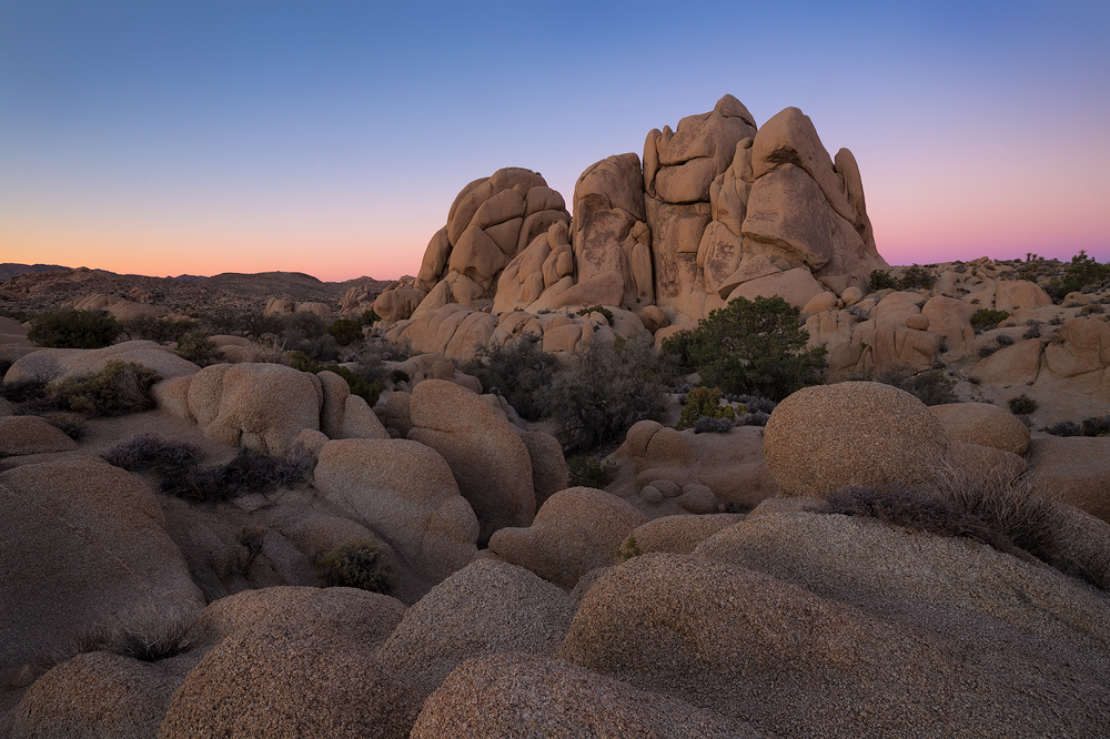 Joshua Tree's granite boulders at twilight.