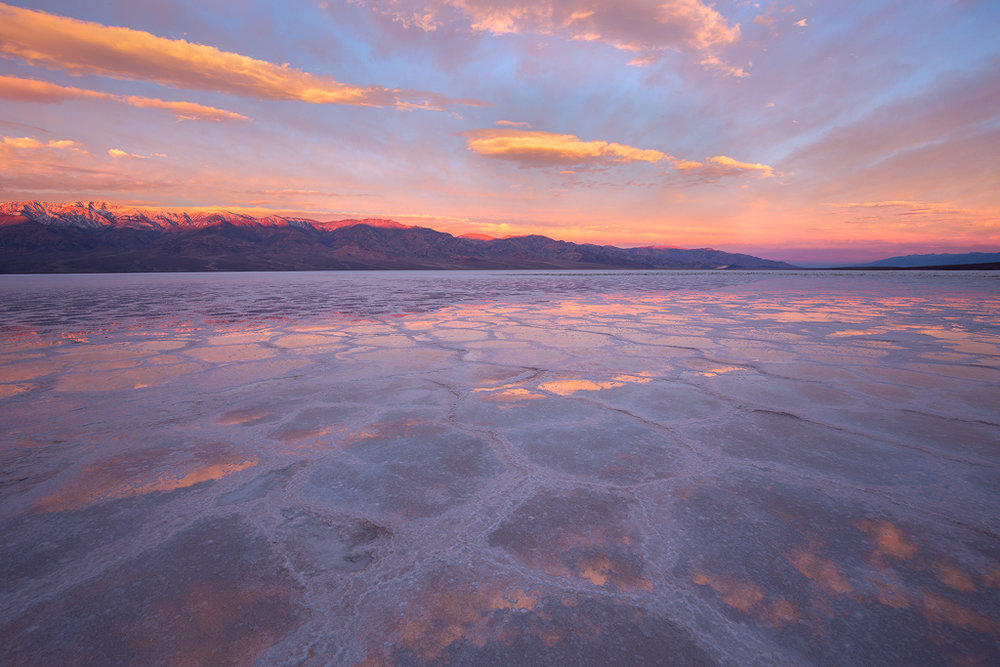 An intense sunrise over a flooded Badwater